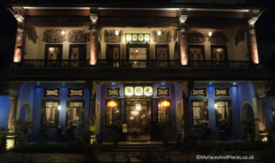 A night image of the Blue Mansion in George Town, Penang. Note the stained glass windows and the fine ceramic friezes on the upper floor.