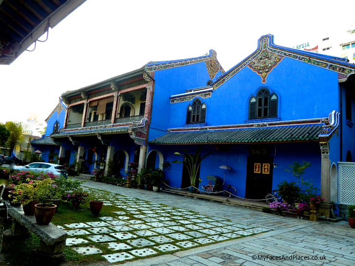The Blue Mansion. Note the louvre windows and ceramic friezes on the wall.