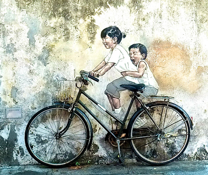"""Little Children on a Bicycle"" (Armenian Street): It depicts a little girl taking her younger brother on a real bicycle ride. From the expressions of their faces, you can see the joy and happiness which brings a cheer to anyone looking at them."