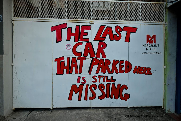 "Using humour in Penang Street Art to make a point rather than a stern warning of ""Cars parked here will be towed away""."