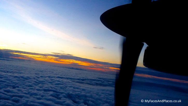 Gaya Island Resort - Vista of a glorious sunrise in the horizon from a MASwings' ART 72-500 – worth getting a window seat.